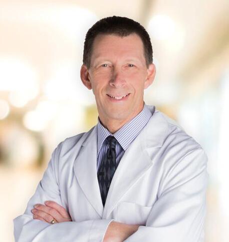 Gregg Moral, MD lab coat photo