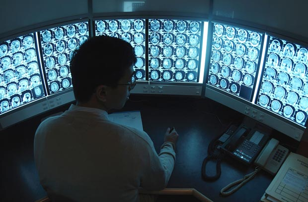 Radiologist in a reading room interpreting a study
